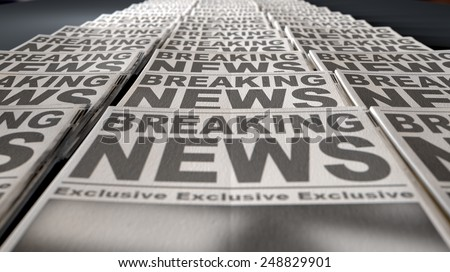A long row of folded newspapers at the end of a press run with a generic headline that reads breaking news on the front page on an isolated white background - stock photo