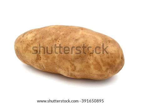 A long russet potato (Idaho potato)  - stock photo