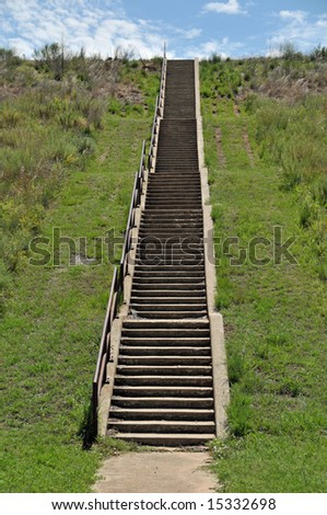 A long series of steps lead up a steep incline - stock photo