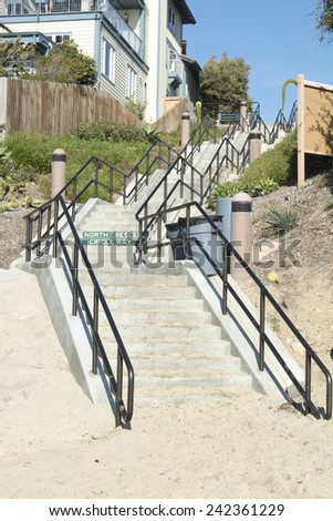 A long stairway leads from the beach cove up to the main street in a Laguna Beach California oceanfront getaway.  - stock photo