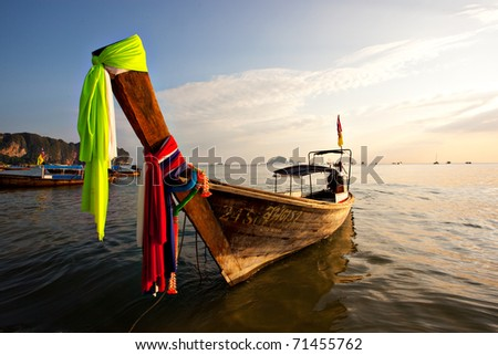 A Long Tail Boat on Ao Nang Beach in Thailand - stock photo