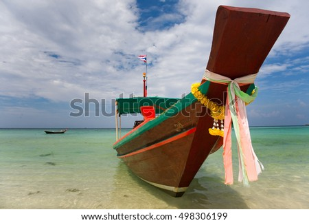 A Long Tail Boat on Haad Salat Beach in Koh Pangan, Thailand