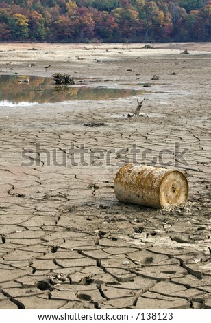 A long term drought in Atlanta takes makes its mark on area lakes.  A drought stricken lake bed  with litter and red clay. - stock photo
