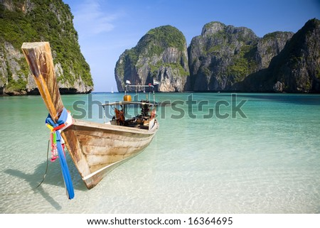 A longtail boat sits in Maya Bay, Koh Phi Phi Ley, Thailand - stock photo