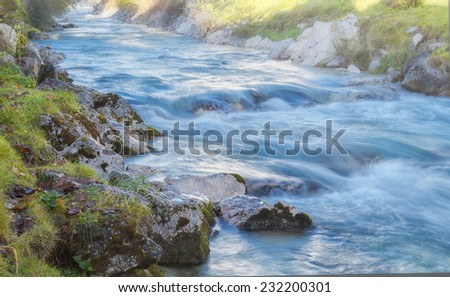 a longtime exposure of a brook .Picture made on a sunny autumn day - stock photo