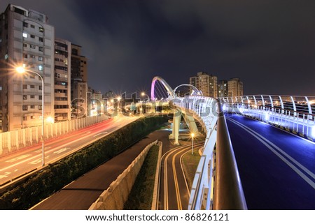 a  look at the expressway from the bridge for the bike in the modern city at night