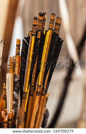 a lot of arrows with tail feathers in a medieval fair - stock photo
