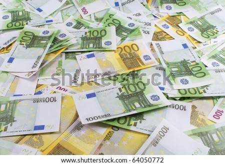A lot of banknotes one hundred and two hundred euro - stock photo
