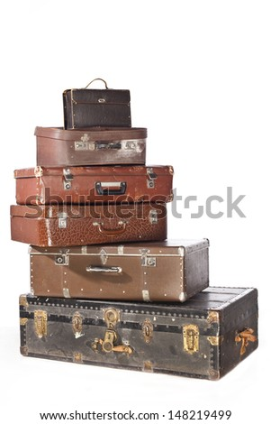 a lot of big old brown suitcase on a white background - stock photo