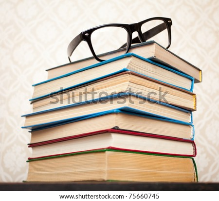 A lot of books for studying and black glasses - stock photo