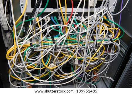 A lot of cables for internet on the back of a big computer - stock photo