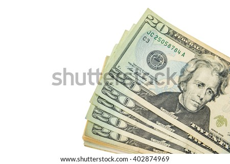 A lot of cash US dollars assorted bills, cash pile on white background. - stock photo