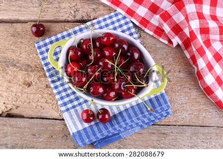 A lot of cherries. Cherries in a bowl on the table. The view from the top. Crop, orchard, berries. Healthy nutrition. Ripe berries. In the kitchen. Diet. Delicious berries. Shiny red berries.  - stock photo