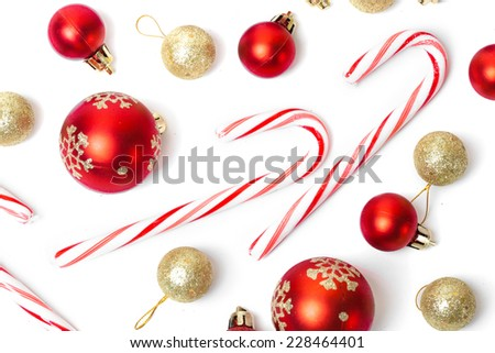 A lot of christmas candies and balls isolated on white background - stock photo