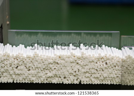 a lot of cigarettes at a tobacco factory - stock photo