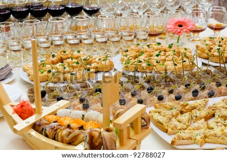 a lot of cold snacks and drinks on buffet table, catering - stock photo