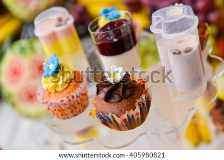 A lot of colored cupcakes in natural light - stock photo