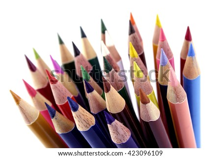 A lot of colored pencils on white background - stock photo