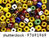 a  lot of colorful beads on plane - stock photo
