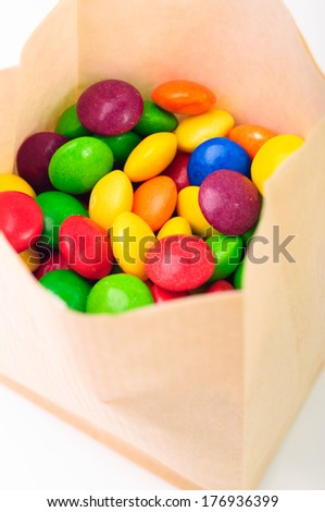 A lot of colorful candies in a bag - stock photo