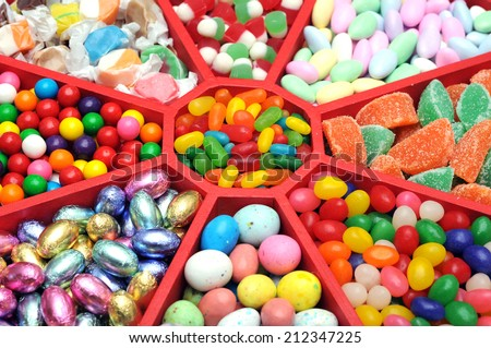a lot of colorful candies  in wooden tray  - stock photo