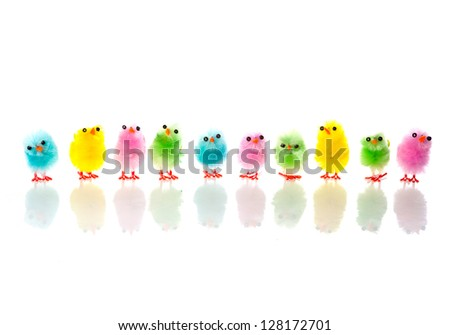 a lot of colorful chickens in a long row - stock photo