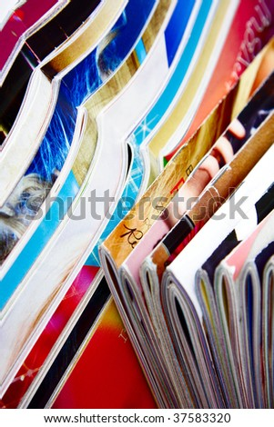 A lot of colorful magazines - stock photo