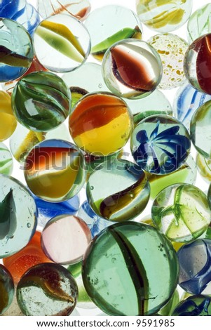 a lot of colorful marbles - closeup - stock photo