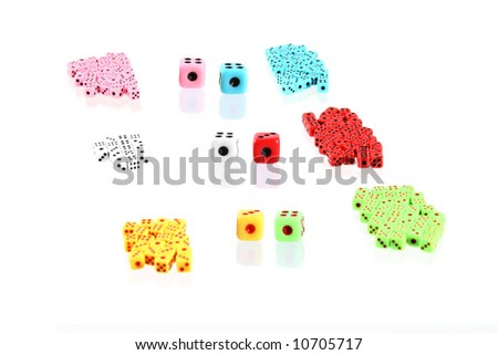 a lot of colorful playing dices (may symbolized teams with  leaders) - stock photo