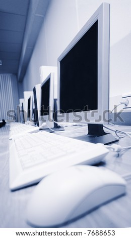a lot of computers in a learning class - stock photo