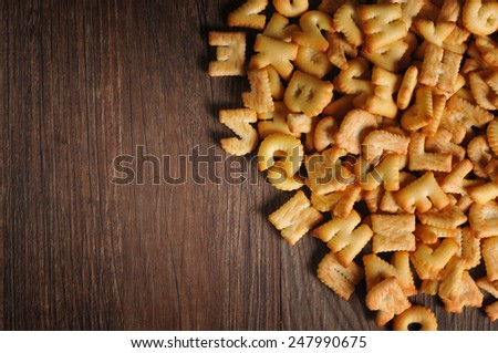 a lot of Cookies ABC alphabet on old wood background, Valentines day - stock photo