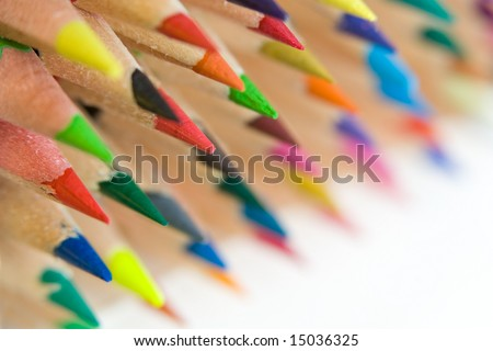 A lot of crayons laying one on another with white background