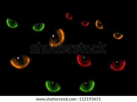 A lot of dangerous wild cat eyes in darkness - stock photo