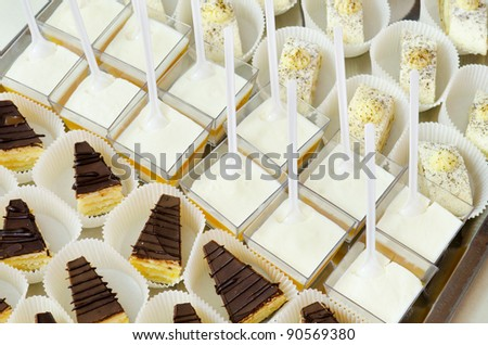 a lot of desserts on buffet table, catering - stock photo