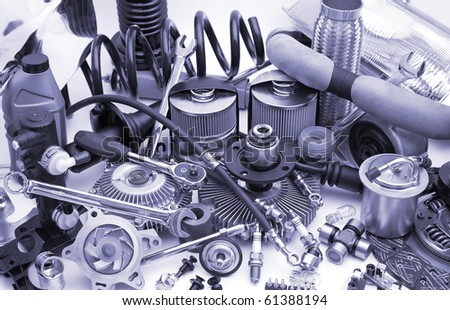 a lot of different auto spare parts, blue toning - stock photo