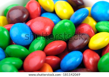 A lot of different color chocolate candies - stock photo