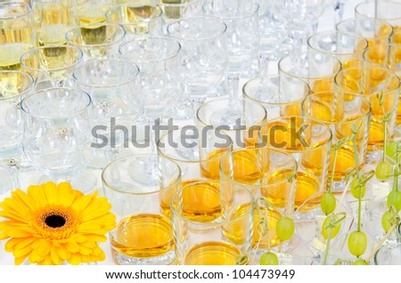 a lot of drinks on buffet table, catering - stock photo