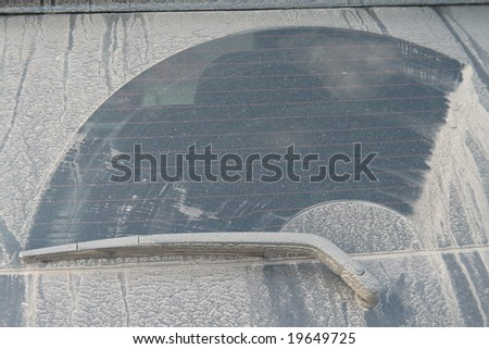 a lot of dust at glass of 4x4 car - stock photo