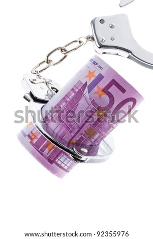 a lot of  euro bank notes with handcuffs - stock photo