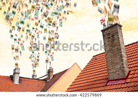a lot of euro money flies up the chimneys - stock photo