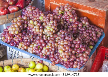 A lot of fresh, violet grapes, Vitis vinifera at a market in Phu quoc, Vietnam
