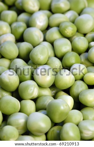 A lot of green peas/Green peas - stock photo