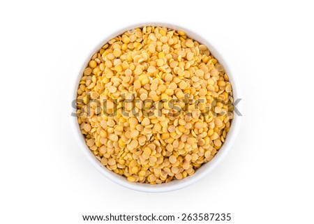 a lot of halved soybean in cup isolated on white background - stock photo