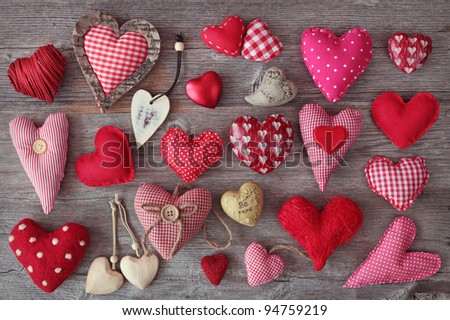 A lot of hearts on wooden background - stock photo