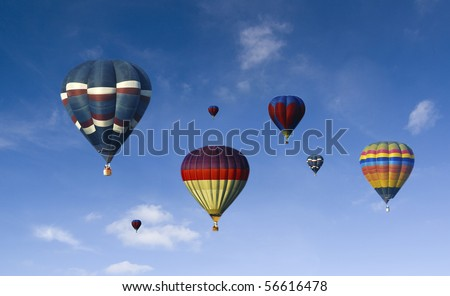 a lot of hot air baloons with blue sky background - stock photo