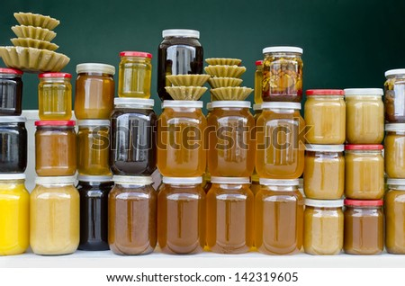 A lot of jars of honey close-up on the counter