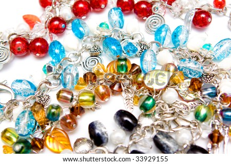 A lot of jewelery on white background - stock photo