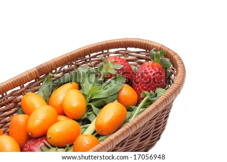 A lot of kumquats and strawberry in a basket isolated on white background - stock photo
