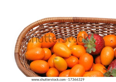 A lot of kumquats and strawberry isolated on the white background - stock photo