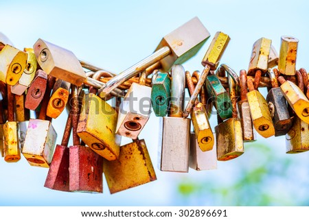 A lot of love padlocks on the bridge. - stock photo